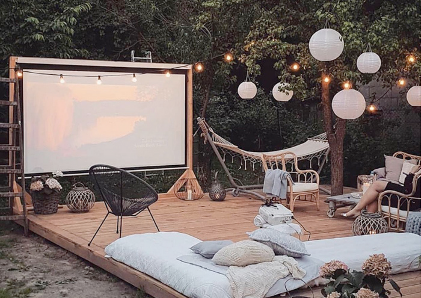 Outdoor cinema set up with lots of soft lighting