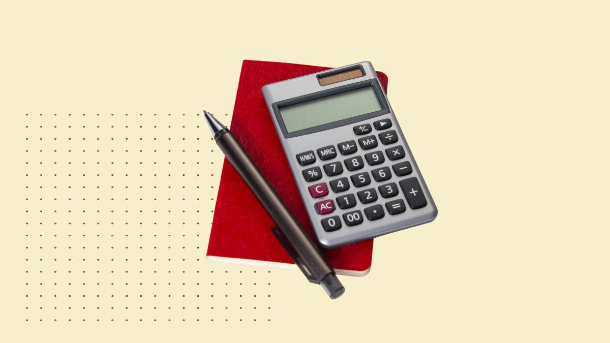 calculator with pen on red sticky note