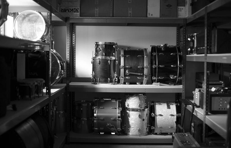 Vintage drums on shelves in storage