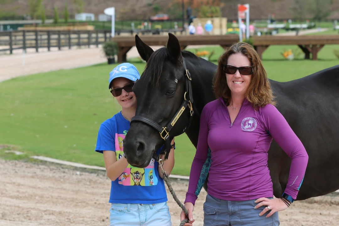 Jen Garutti and her daughter Devon at the 2017 American Eventing Championships in Tryon, NC. Devon has been riding with Kep for a few years now and has seen her confidence soar. Photo courtesy of Amber Heintzberger.