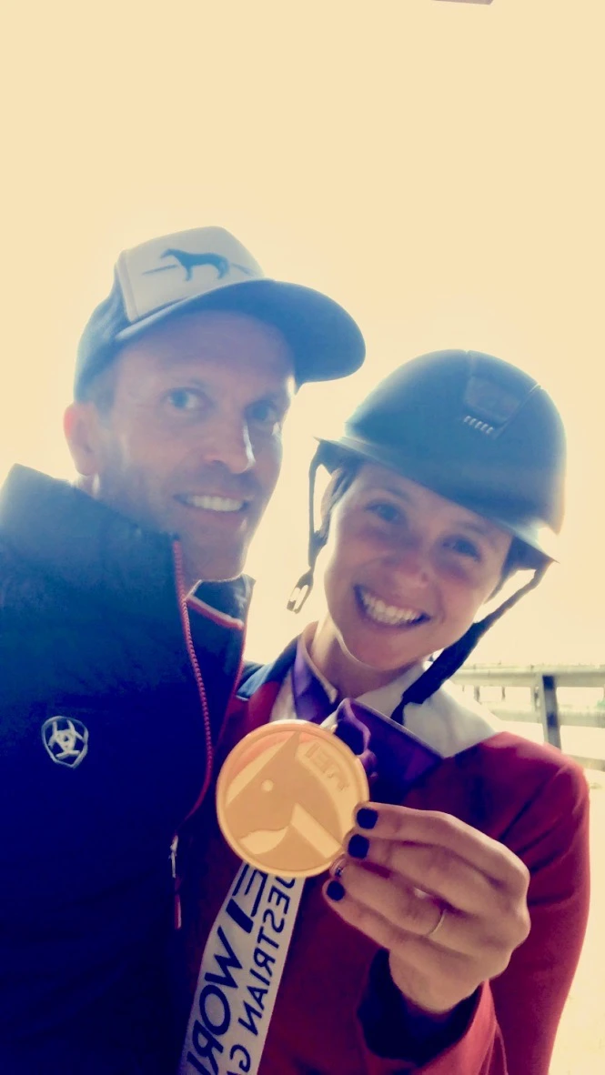 Peter Crone with top American Showjumper Adrienne Sternlicht when she won the team gold medal at the 2018 World Equestrian Games. Image courtesy of Peter Crone.