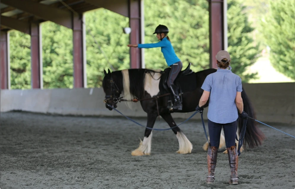 Longe line lessons can help riders learn the basic riding position and alignment. Image courtesy of Amber Heintzberger.