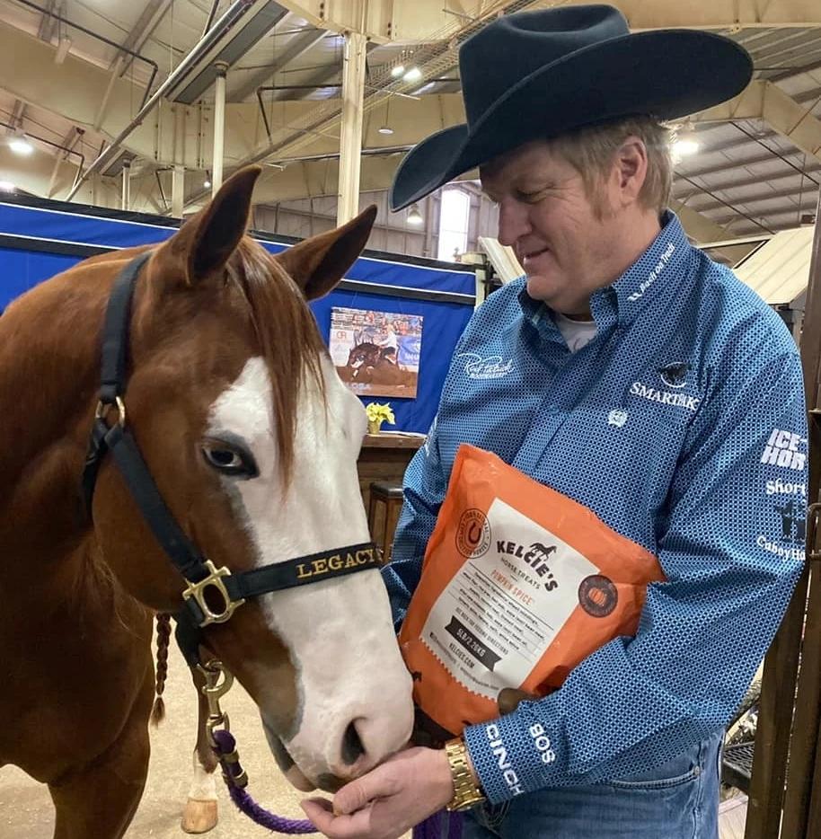 Reining's Tom McCutcheon feeds his horses Kelcie's Horse Treats. Image courtesy of Kelcie's Horse Treats.