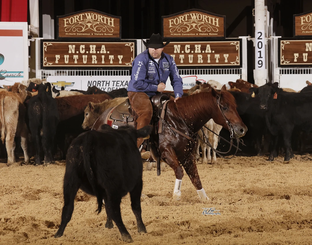 Grant Setnicka and Spooky's Honey Badger, owned by Cody Erwin, at the 2019 NCHA Futurity. Photo courtesy of Ted Petit Photography.