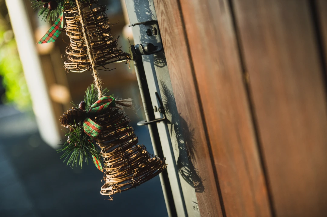 Bells are festive in look and sound while remaining safe and fairly uninteresting to animals.