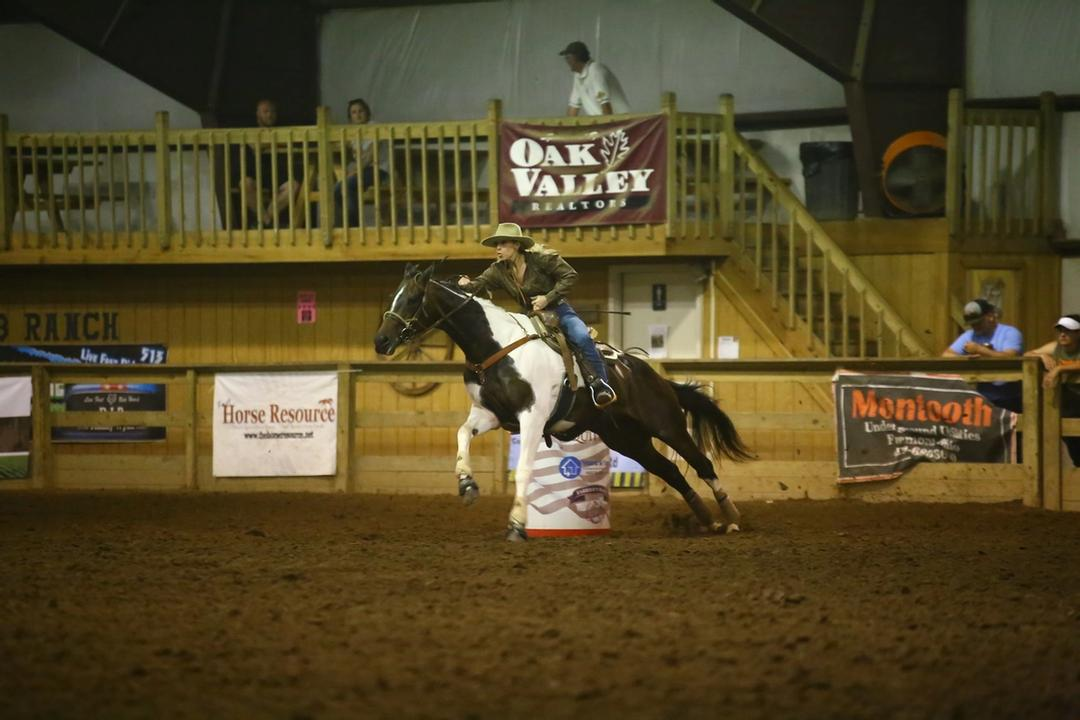Image of barrel racer Madeline Grothaus of Big Ten Ranch an her horse Candy Crackers. Candy Crackers (2006 Paint Appendix- Mare) has around $40,000 in earnings throughout her career.