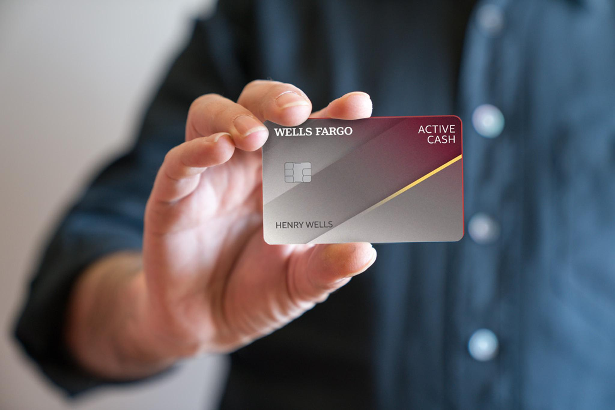 Lady holding Bank of America Customized Cash Rewards credit card