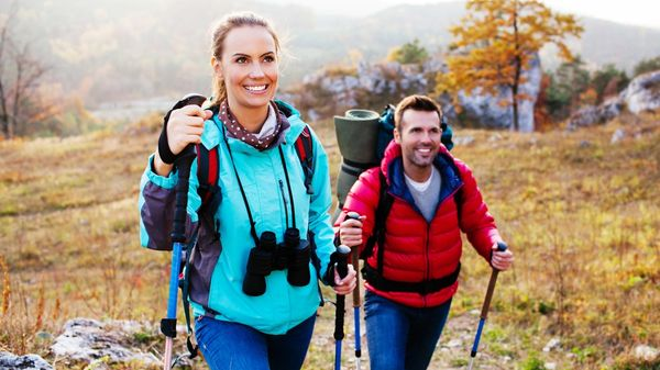 A couple finding peace and wellness on a hike in the fall