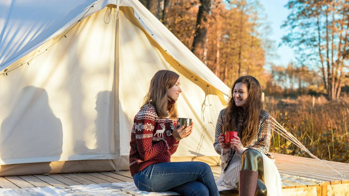 Two women prepared to enjoy a well deserved glamping trip