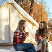 A fully decorated and furnished glamping tent