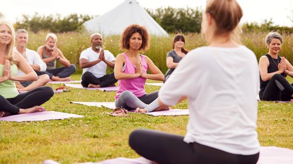 A group of tourists enjoys a mindful yoga experience while on vacation