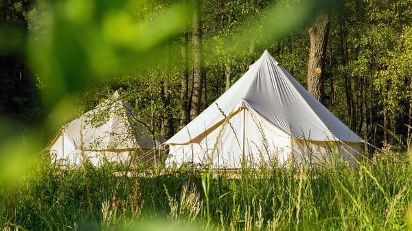 A canvas tents and a semi permanent deck often used for glamping