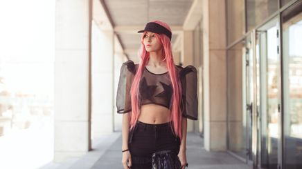 An Asian woman with extra-long pink hair