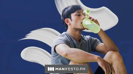 Man drinking a bottle of water