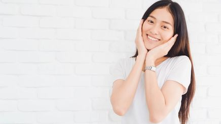 A happy and relieved Asian woman