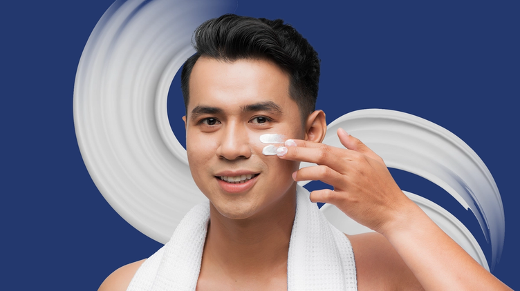 A man applying skincare products