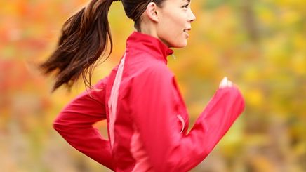 Woman wearing a ponytail running outdoors