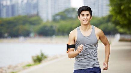 Young Asian man jogging