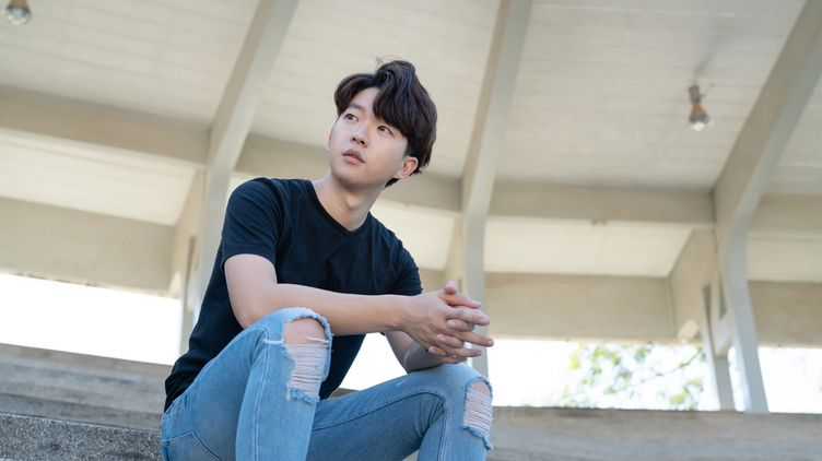 Korean young man in a black shirt and jeans