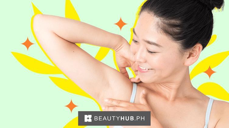 Asian woman touching underarms