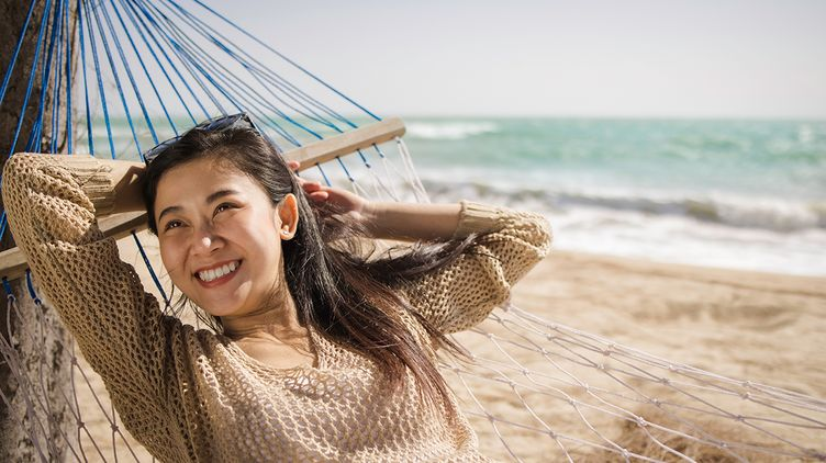 Asian woman happy at the beach