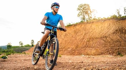 Asian man cycling outdoors