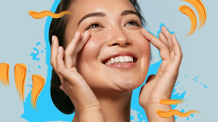 a beautiful woman smiling while gently touching her under eye area