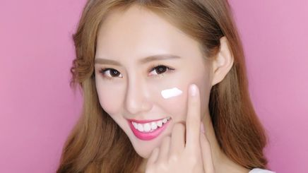 Woman moisturizing her face.