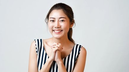 Asian woman with clean, glowing complexion