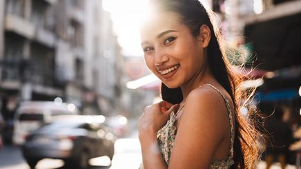 Asian woman on the street under the scorching sun