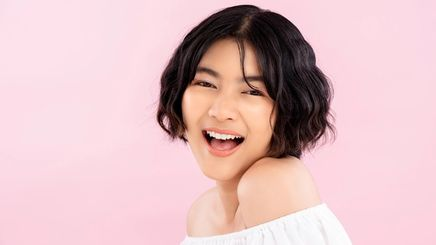 Smiling young Asian woman with Korean short hairstyle