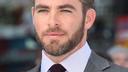 Chris Pine with beard in a gray suit