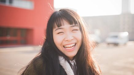 Asian woman with long hair and bangs
