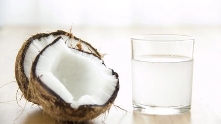 Coconut and coconut water in a glass