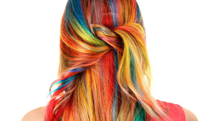Back view of a woman with rainbow hair