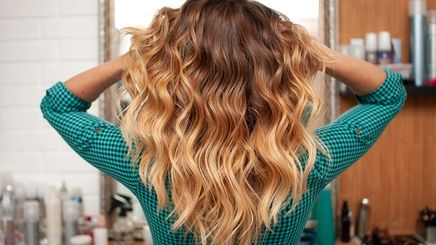 Girl with brown to blonde ombre hair