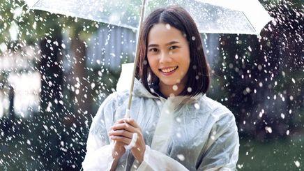 Asian woman carrying an umbrella in the rain