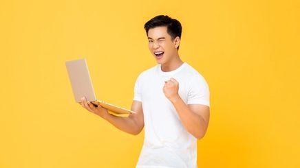 Man holding a laptop.