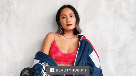 Laureen Uy wearing red sneakers, baggy pants, and red sports bra