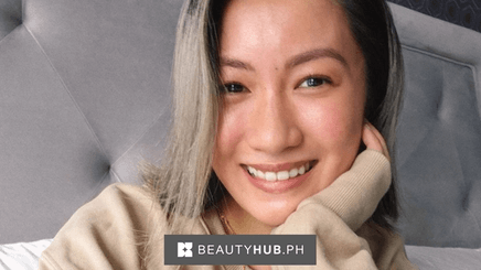 A close-up image of Laureen Uy with her hand on her face