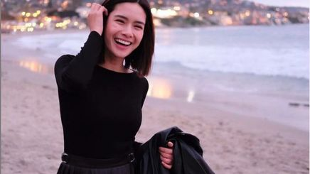 Erich Gonzales wearing black and smiling at the beach