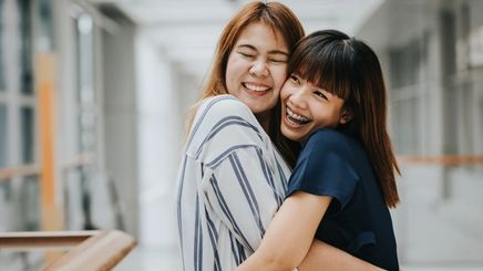 Two female friends hugging each other