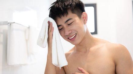 Asian man holding a towel
