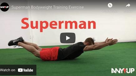 A man doing a superman exercise