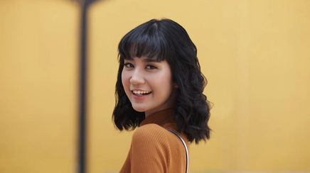 a woman with short hair and bangs