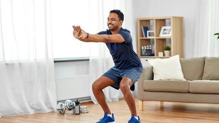 A moreno man exercising at home
