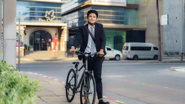 Asian businessman on a bike