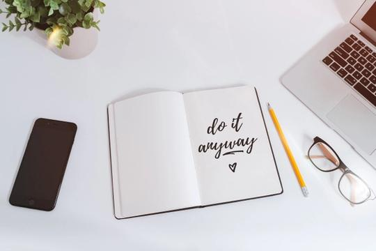Notebook with a written note that says