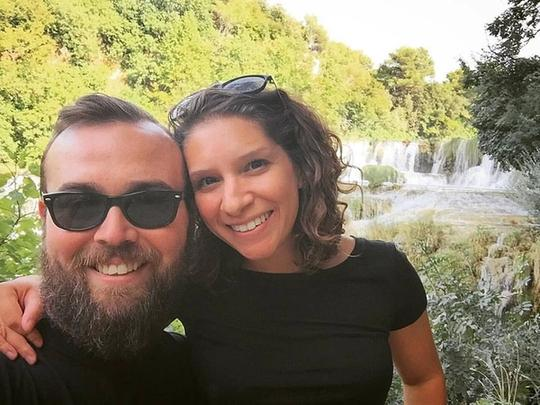 Jason and I standing in front of a waterfall in Krka, Croatia