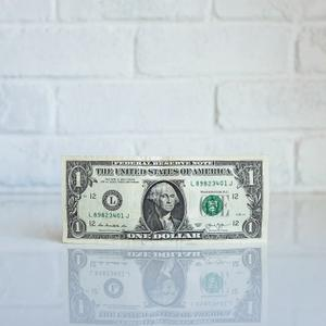 A dollar bill on a white background
